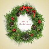 a natural christmas wreath and the sentence merry christmas written on a beige background, with a retro effect