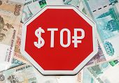 Finance Concept With Usd And Russian Money As A Stop Road Sign Isolated On White