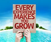 Every Experience Makes You Grow card with a beach on background