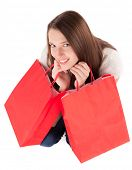 Isolated young woman with shopping bags on white background.