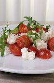 Salad Arugula With Cherry Tomatoes And Mozzarella
