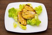 Fried fish on wood