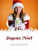 pretty girl in santa costume holding gift box against joyeux noel