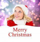 happy festive blonde against merry christmas