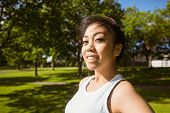 Portrait of healthy and beautiful young woman in park