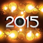 beautiful shiny 2015 with clock pointing to 12am placed on glowing golden background
