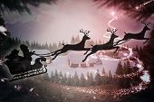 Silhouette of santa claus and reindeer against cute village in the snow