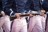 NEW YORK - NOV 11, 2014: Participants wearing blue and white military uniforms hold parade rifles during the 2014 America's Parade held on Veterans Day in New York City on November 11, 2014.