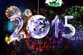 2015 against colourful fireworks exploding on black background
