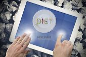 Diet new years resolution against hands touching tablet screen
