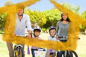 Family with their bikes against house outline in clouds
