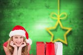 Smiling woman lying between shopping bags against blurred christmas background