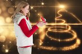 Surprised blonde woman opening gift against christmas light design
