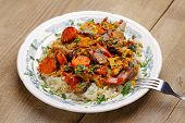 Lamb Ragout With Vegetables And Rice In White Plate