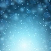 Winter background with snow. Christmas blue defocused illustration. Eps10 vector.