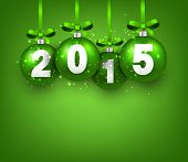 Realistic green christmas balls with 2015. Vector illustration.