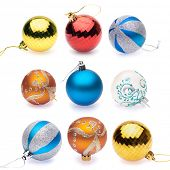 orange, blue, blue-silver, red, yellow, white christmas balls on white background