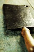 Meat cleaver knife on dark vintage background