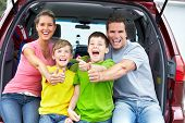 stock photo of family fun  - Smiling happy family and a family car - JPG