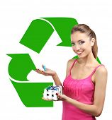 Recycle concept, beautiful young woman holding batteries isolated on white