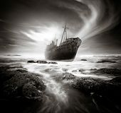 pic of shipwreck  - Shipwreck along a rough and rocky coastline - JPG