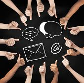 gesture, people, online communication and internet concept - human hands showing thumbs up in circle over black board background with e-mail symbols