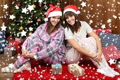 Beautiful young sisters twins. Christmas and New Year