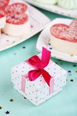 Cute gift on birthday table close-up