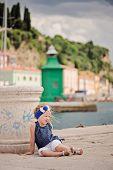 cute child girl in marina in piran, slovenia
