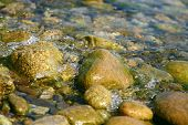 stock photo of h20  - Shallow water on coast of lake  - JPG
