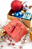 Red Gift Box With Christmas Tree Bauble And Ornament