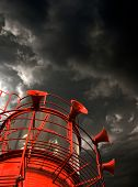 Red Lightship With Fog Horns Against Storm Clouds