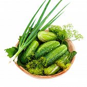 Cucumbers And Vegetables And Dill Leaves Still Life In Wooden Bowl Isolated On White Background.