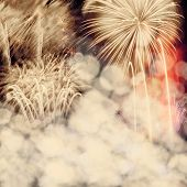 Abstract holiday background with fireworks at New Year and copy space
