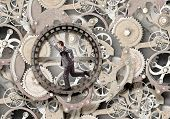 Young businessman in suit running in hamster wheel