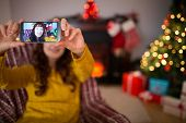 Beauty redhead taking a selfie at christmas at home in the living room