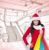 Brunette in winter clothes holding shopping bags against blue abstract light spot design