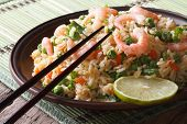 Fried Rice With Egg, Shrimp And Vegetables Close-up Horizontal