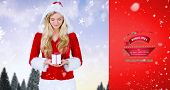 pretty girl in santa outfit holding gift against red vignette