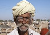 Old Cattle Farmer With Turban And Glasses.
