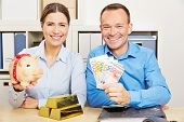 Couple with money and gold and piggy bank for financial security