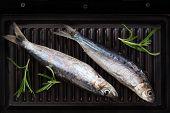 Two Fresh Fish On Roast.