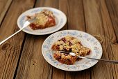Plum Crumble On Wooden Background