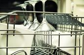 pic of dishwasher  - details of Open dishwasher with clean utensils - JPG