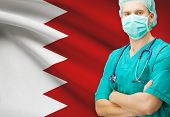 image of bahrain  - Surgeon with national flag on background  - JPG