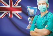 stock photo of falklands  - Surgeon with national flag on background  - JPG