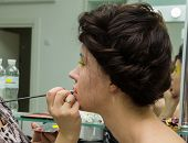 picture of makeup artist  - The process of applying color to the face makeup on model - JPG