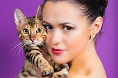 picture of bengal cat  - Cute brunette girl holding a Bengal cat - JPG