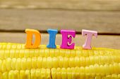 picture of corn cob close-up  - Wooden Sign Diet On Fresh Sweet Corn Close - JPG