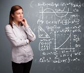 pic of mathematics  - Beautiful young school girl thinking about complex mathematical signs - JPG